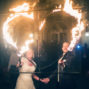 bride and groom lighting up a heart of fire