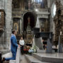 bride and groom receive benediction from the priest