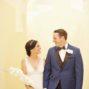 elopement couple walking together in santorini santa irini chapel