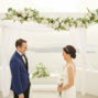 groom and bride elopement ceremony in santorini santa irini chapel